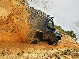 A 4x4 driving through the sand road track