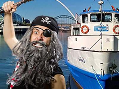 An image of a blue and white boat on the River Tyne, and a man in a pirate costume