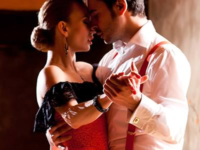 A man and a woman dancing passionate salsa dance together