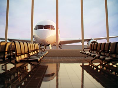 An empty departure lounge with a plane visible through the floor to ceiling windows in the background