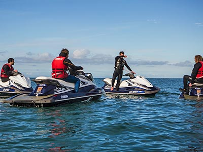 A group of people on jet skis in the water
