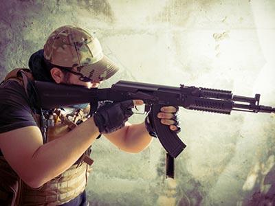 A man aiming a gun