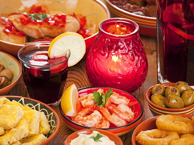 A table of tapas with a glass of Sangria