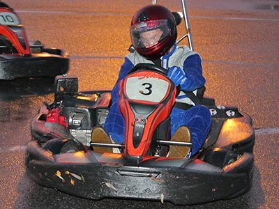 Someone in a go kart on a track