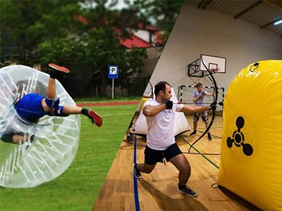 Split image of a man rolled over in a inflatable ball and a guy aiming archery bow hiding behind a yellow inflatable