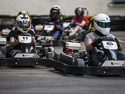 A group of people driving go-karts