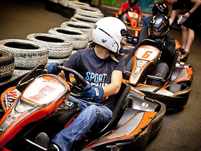 A group of people in go-karts about to start a race