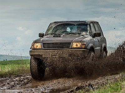 A 4x4 on a dirt track