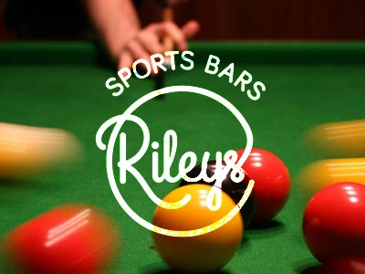 Pool balls getting scattered with Rileys logo over