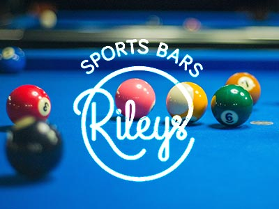 Snooker balls on a blue table and the Rileys logo over