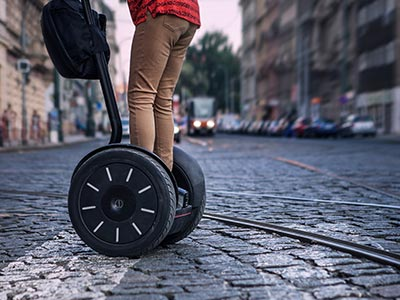 A close up of someone on a segway