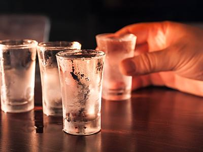 Image of four cold shots of vodka
