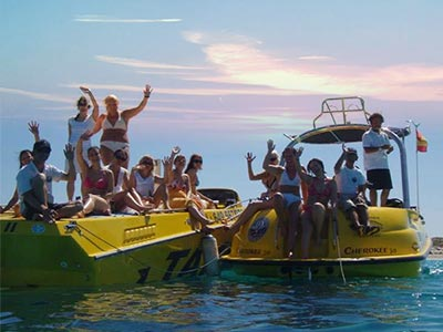 A group of people on speedboats