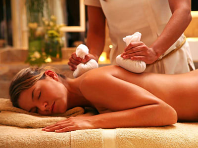 A woman in a spa receiving a massage