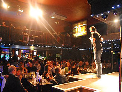 Man on the stage performing stand up comedy