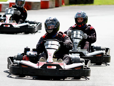 Person driving a go kart on a track