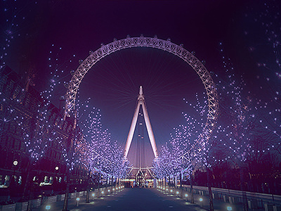 London Eye illuminated at night, behind an avenue of trees