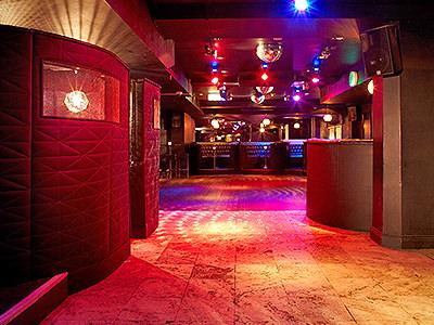An empty dance floor lit up
