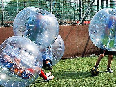 A group of people playing bubble football