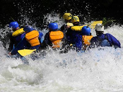A raft being paddled through turbulent rapids