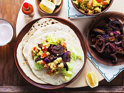 A top-down view of tortillas and other Mexican foods