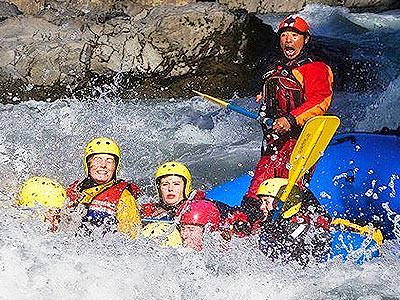 A raft being paddled through turbulent rapids