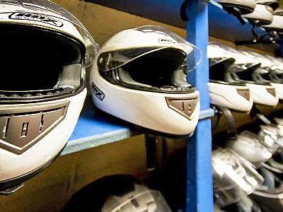 White helmets lines up on shelves