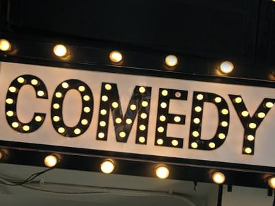 Close up of the word Comedy, lit up on a sign
