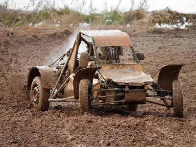 A rage buggy in a muddy field