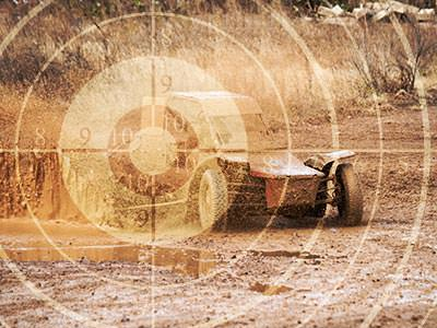 A faded image of a sniper target, over a faded image of a rage buggy in the mud