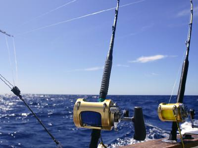 Close up of fishing equipment on a boat to a backdrop of the sea