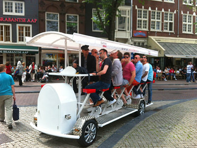 A group of men riding on a beer bike