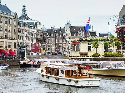 Some boats travelling into the main port in Amsterdam
