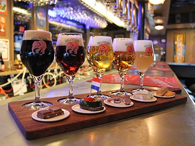 Four sample beers in a sampling rack