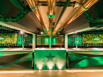 An empty, green bar in the Heineken factory