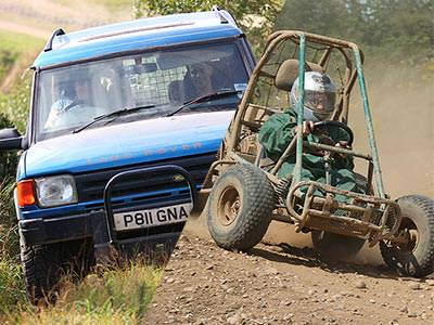 A split image of a Land Rover driving over grass and an off-road buggy on a dirt track