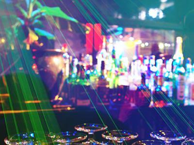 A cocktail bar under disco lights