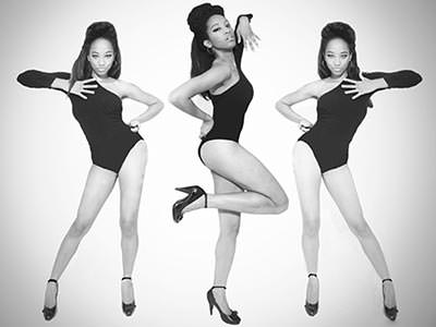 Black and white tiled image of a woman in a black leotard dancing face on, and on the side