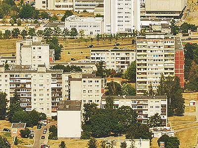 A view over white residential buildings