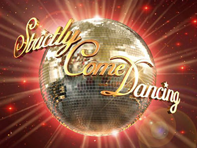 Gold Strictly Come Dancing lettering over a glitter disco ball, on a red backdrop