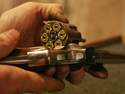 Close up of the barrel of a pistol filled with bullets