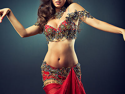 A woman dressed in a red Bollywood outfit