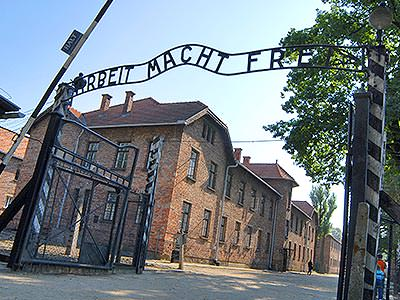 The outside gate of Auschwitz, with the main building in the background