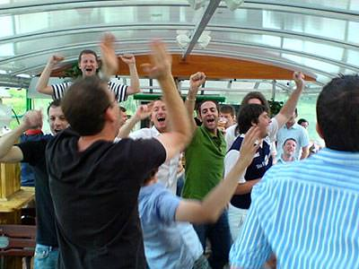 Men dancing inside a boat