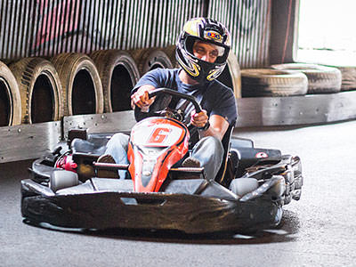A man driving around a go karting track