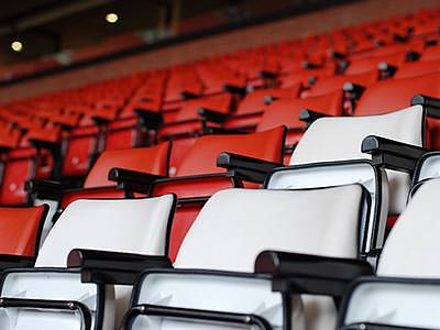 Some empty seats in a football stadium