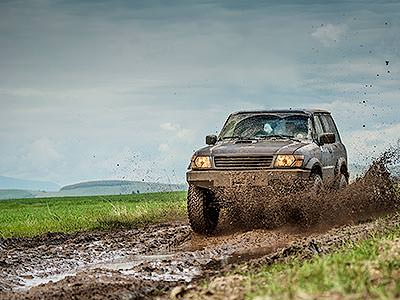 A 4x4 driving through the mud