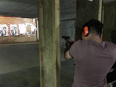 A man about to fire a gun at a target