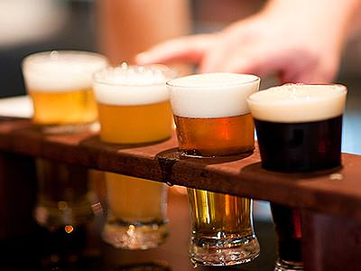 Four craft beers in a rack