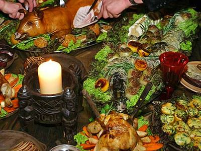 A medieval feast with a candle in a balck holder